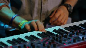 Professional Playing Piano. Hands red synthesizer at a jazz concert smooth zoom in closeup