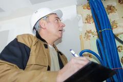 Professional plumber checking installation water pipes Stock Photos
