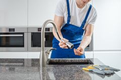 Professional plumber exchanging strainer Stock Photography