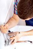 Professional plumber repairing a tap Royalty Free Stock Photo