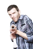 Professional Plumber Troubleshooting Blocked Pipe. Young Male Plumber Fixing A Sink Water Pipe With Sharp Shooting Skills On White Background Royalty Free Stock Image