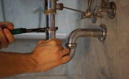 Plumbing repair service. Professional plumbing repair service with spanner Stock Photos