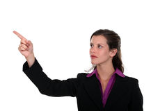 Professional pointing her index finger Royalty Free Stock Photography