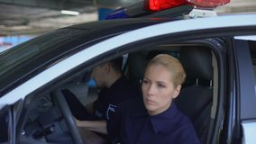 Professional police officers getting out from patrol car arriving at crime scene. Stock footage stock video