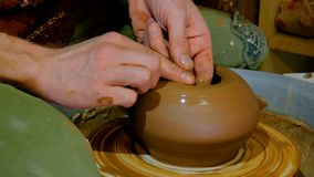 Professional potter shaping bowl with special tool in pottery workshop Stock Photography