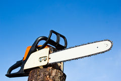 Professional Power Chainsaw. Orange chainsaw with emphasis in blade royalty free stock photos