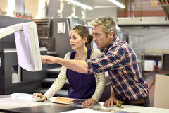 Professional printer working with apprentice Royalty Free Stock Photos