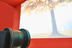 Professional video projector lens. Professional projector lens and screen cinema royalty free stock images