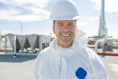 Professional in protective uniform, gloves in the roof for cleaning Royalty Free Stock Photos