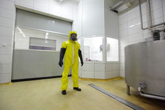 Professional in protective suit in plant Stock Photo