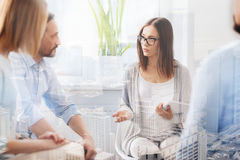 Professional psychologist conducting a group session stock photography