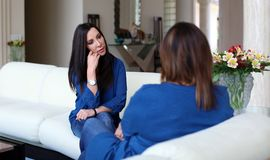 Professional psychologist female doctor dark hair with patient. Mother and daughter sharing a positive time. Stock Photo