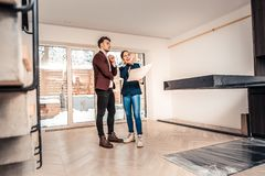 Professional realtor telling about characteristics of the house. Characteristics of house. Professional experienced realtor telling about characteristics of the royalty free stock images