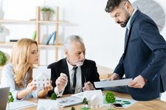 Professional realtors having an important meeting and looking concentrated royalty free stock photos
