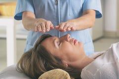 Professional Reiki healer doing reiki royalty free stock images
