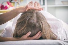 Professional Reiki healer doing reiki stock photo