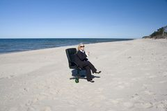 Professional relaxing on beach Stock Photo