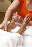 Professional relaxing foot massage, various techniques Royalty Free Stock Photos