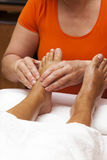 Professional relaxing foot massage, various techniques Stock Photo