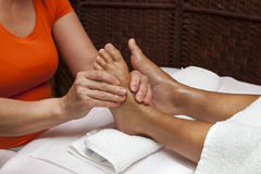 Professional relaxing foot massage, various techniques Royalty Free Stock Images