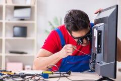 The professional repair engineer repairing broken tv. Professional repair engineer repairing broken tv Royalty Free Stock Photos