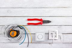 Professional repairing implements for decorating and building renovation set in the wooden background, electrician. Professional repairing implements for Royalty Free Stock Photos