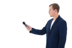 Professional reporter holding a microphone isolated on white bac. Young professional reporter holding a microphone isolated on white background Royalty Free Stock Image