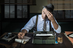 Professional reporter working late at night Royalty Free Stock Photos