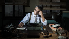 Professional reporter working late at night Stock Images