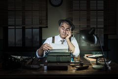 Professional reporter working late at night Stock Photography
