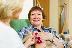 Professional retirement home employee offering  mixture to  pati Stock Photos