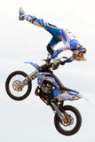 A professional rider at the FMX (Freestyle Motocross) competition at LKXA Extreme Sports. BARCELONA - JUN 28: A professional rider at the FMX (Freestyle Royalty Free Stock Photo