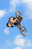 A professional rider at the MTB (Mountain Biking) competition Royalty Free Stock Image