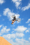 A professional rider at the MTB (Mountain Biking) competition on the Dirt Track Royalty Free Stock Images