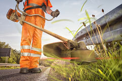 Professional roadside mowing Stock Photography