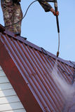 Professional roof washing. Royalty Free Stock Photography