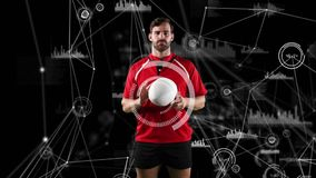 Professional rugby player holding a ball and medical data