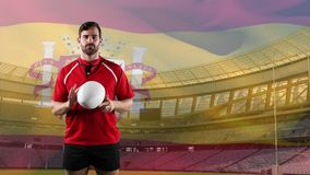 Professional rugby player standing in front of a flag and stadium stock illustration