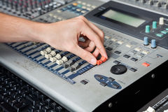 Professional's Hand Working On Audio Mixer In Studio Royalty Free Stock Photography