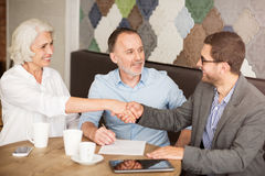 Professional sales manager shaking hands with pleasant woman Stock Image