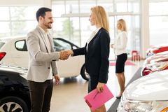 Professional salesperson in car dealership. Professional salesperson working in car dealership royalty free stock photography