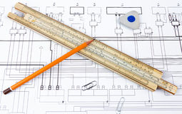 Professional scale ruler, pencil and eraser on the blueprint Royalty Free Stock Photography