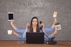 Professional secretary has a large number of hands, a multi-tasking businesswoman concept stock image