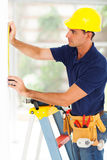 Security system installer. Professional security surveillance system installer installing a cctv camera Stock Image