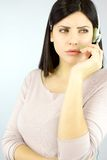 Professional serious woman talking on the phone with headset Stock Images