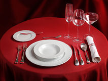 Professional setting of red dinner table Stock Photos