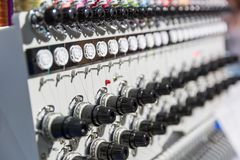 Professional sewing machine closeup, nobody. Textile fabric. Factory production, sew manufacturing, needlework technology Royalty Free Stock Images