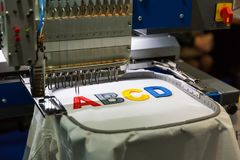 Free Professional Sewing Machine Embroidery Letters Royalty Free Stock Photos - 100550008