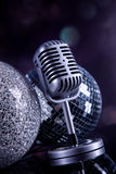 Professional silver microphone. On a black glossy background royalty free stock photography