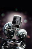 Professional silver microphone. On a black glossy background stock image